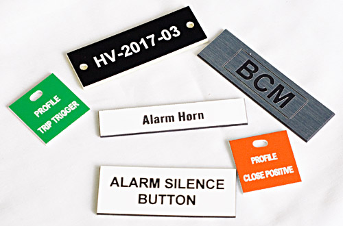 Six Plastic Engraved Tags in Black, White, Red, and Green